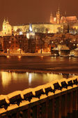 Night colorful snowy Prague gothic Castle with Charles Bridge — Stock Photo