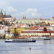 Stock Photo: First Snow in Prague City, gothic Castle above River Vltava