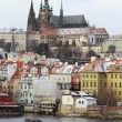 Stockfoto: First Snow in Prague City, gothic Castle above River Vltava