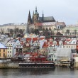 First Snow in Prague City, gothic Castle above River Vltava — Foto de stock #38675911