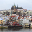 Foto de Stock  : First Snow in Prague City, gothic Castle above River Vltava