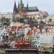 First Snow in Prague City, gothic Castle above River Vltava — стоковое фото #38675981