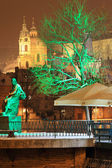 Night romantic snowy Prague St. Nicholas' Cathedral, Czech republic — Stock Photo