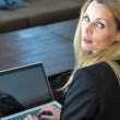 A young business woman using a lap top — Stock fotografie