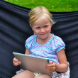 Happy child with tablet — Stock Photo