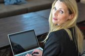 A young business woman using a lap top — Stock Photo