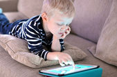 Child with tablet — Stock Photo
