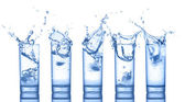 Set of water splash in glasses — Stock Photo