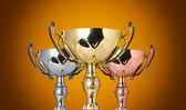 Close up trophies on yellow background — Stok fotoğraf