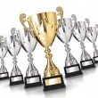 Golden trophy among many silver trophies — Stock Photo