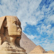 A beautiful profile of the Great Sphinx including the pyramids of Menkaure and Khafre in the background in Giza, Cairo, Egypt — Stock Photo