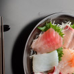 Various kind of fresh raw sashimi — Stock Photo