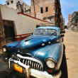 Old american car parked in street in havana-cuba — Stock Photo