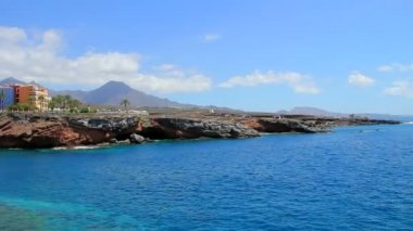 Luxury houses on beautiful coast. Playa Paraiso one of famous district in Tenerife island for travel, rent or buy property — Wideo stockowe
