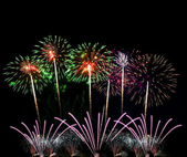 Colorful fireworks of various colors over night sky — Foto de Stock