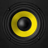 Black & yellow speaker — Stock Photo