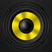 Black & yellow speaker with a metal membrane — Stock Photo