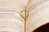 Wedding ring on a book — ストック写真