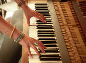 Woman's hands playing the piano — Stock Photo