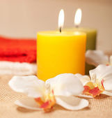 Two towels with orchid and candles — Stock Photo