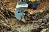 Excavator pours stones — Stock Photo