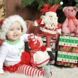 Girl in a Christmas with gifts — Stock Photo