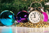 Christmas balls and clock — Stock Photo