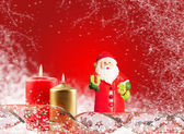Santa Claus and a candle on a red background — Stok fotoğraf