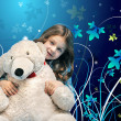 Caucasian little girl with a polar bear — Stock Photo
