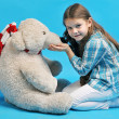 Caucasian little girl with a polar bear — Stock Photo #35607117