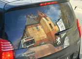 Reflected in the window of the car — Stock Photo