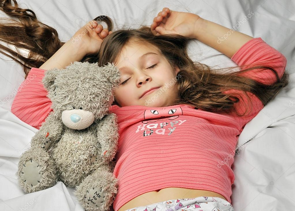 Little girl sleeping in bed — Stock Photo © nelyninell #35880709