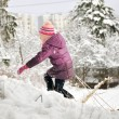 Girl pulling sleigh in winter mountain — Stock Photo