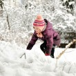 Little girl playing in the snow — Stock Photo