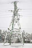 Electric pole in winter — Stock Photo