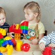 Stockfoto: Three children playing with toys