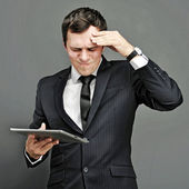 Young business man thinking — Stock Photo