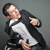 Drunk young man in office clothes — Stockfoto