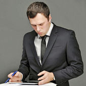 Business young man with tablet — Stockfoto