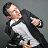 Drunk young man in office clothes — Stock Photo