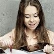Stock Photo: Young girl with pen and tablet