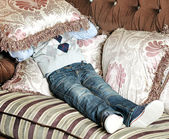 Boy covers his face with a pillow — Foto de Stock