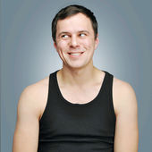 Happy young man in a black t-shirt — Stock Photo