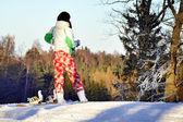 Girl dressed snowboarder — Stock Photo