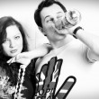 Black and white photo girl and the guy with a bottle — Stock Photo