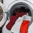 Open washing machine with towels — Stock Photo