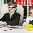 Stock Photo: Boy and girl sitting at a table in the school