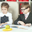Stock Photo: Boy and girl children indulge in school
