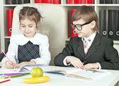 Boy and girl children indulge in school — Stock Photo