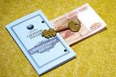 Russian money, passbook, and key. — Stock Photo